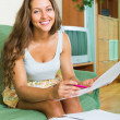 Woman filling papers at home — Stock Photo #66645291