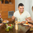 Family of four eating spaghetti — Stock Photo #66646419