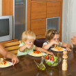 Happy family of four  having lunch — Stock Photo #66646425