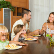 Family of four eating spaghetti — Stock Photo #66646437