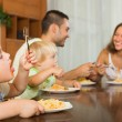 Family eating spaghetti — Stock Photo #66646519