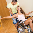 Girl in wheelchair playing with friend  — Stock Photo #66648305