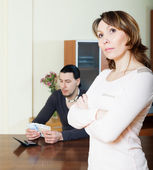 Sad woman against man with money — Stock Photo