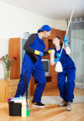 Smiling cleaning premises team at work — Stock Photo