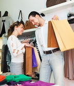 Man and woman with shopping bags at store — Stock Photo