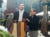 Man and girl with purchases at street — Stock Photo