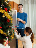 Adult couple cleaning living room — Stock Photo
