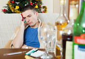 Young hungover guy — Stock Photo