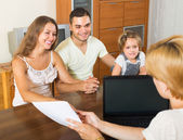 Family with insurance agent — Stock Photo