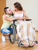 Happy couple with disabled spouse — Stock Photo