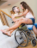 Romantic relationships in invalid chair — Stock Photo