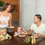 Family of four eating spaghetti — Stock Photo #66651609