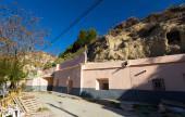 Dwellings houses into rock — Stock Photo
