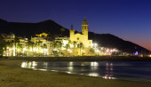 Night  of  Sitges with Church and sea  — Stockfoto