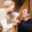 Happy spouses leaning against stairway — Stock Photo #69344969