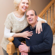 Mature couple near staircase — Stock Photo #69344979