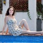Girl in dress resting near pool — Stock Photo #69347987