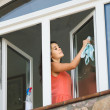 Maid cleaning windows — Stock Photo #69348193