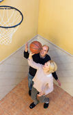 Mature spouses throwing ball — Stock Photo