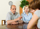 Mature parents scolding adult daughter — Stock Photo