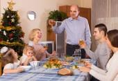 Christmas celebration in bosom of family — Stock Photo