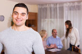 Man staying near family members — Stock Photo