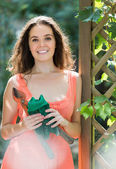 Woman in dress with pruner — Stockfoto