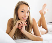 Woman posing on bed — Stock Photo