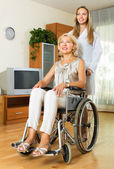Physician and disabled woman communicating — Stock Photo
