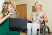 Social worker and handicapped woman — Stock Photo