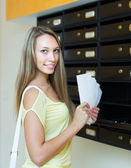 Young girl near posting box — Stock Photo