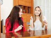Happy women with pregnancy test — Stock Photo