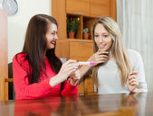Smiling women with pregnancy test at table  — Stock Photo