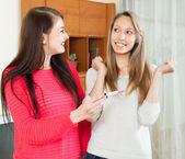 Happy girls with pregnancy test   — Stock Photo