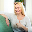 Charming blonde showing thumbs up — Stock Photo #69381765