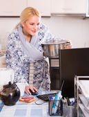 Freelancer with dishware working on PC — Stock Photo