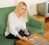 Woman with cards in home interior — Stock Photo