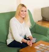 Housewife telling fortunes by cards — Stock Photo