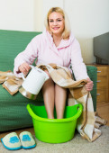 Blonde taking foot bath at home — Stock Photo