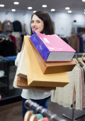 Ordinary girl with shopping bags — Stock Photo