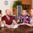 Two couples discussing  and smiling — Stock Photo #69392253