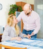 Couple with documents indoor — Stock Photo