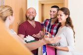 Happy guests in doorway — Stock Photo