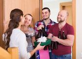 Adults drinking beer indoor — Stock Photo
