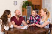 Two couples discussing  and smiling — Stock Photo