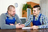 Two workers study documents — Stock Photo