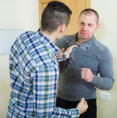 Men clenching fists — Stock Photo