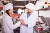 Chef and his helper at bistro kitchen — Stock Photo