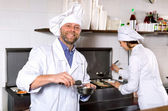 Professional chefs working at take-away — Stock Photo