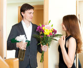 Man giving gifts to cute woman — Stock Photo